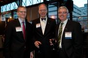 (From left) Bank of America's Scott McCarty and David Gutzke and Kirby Law, both from U.S. Bank
