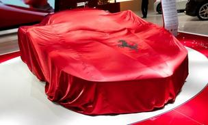 La Ferrari F150 automobile, produced by Ferrari SpA, remains covered on the first day of the 83rd Geneva International Motor Show in Geneva, Switzerland, on Tuesday, March 5, 2013.
