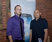Metro PCS assistant store managers Sean McEndree and Quoc Nguyen pose at the Sacramento Asian Pacific Chamber's Lunar New Year celebration.