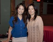 Asian Resources executive assistant Thyan Pham and community specialist Phung Vao pose at the Sacramento Asian Pacific Chamber's Lunar New Year celebration.