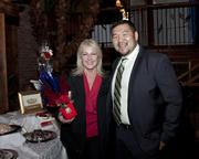 The Chocolate Architect owner and founder Becki DeKoning Tyner and SAFE Credit Union relationship representative Kao Saephanh pose at the Sacramento Asian Pacific Chamber's Lunar New Year celebration.
