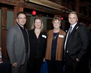 Siemens director of proposal and portfolio development Jean-Luc Picard, Siemens director of financial excellence Michelle Picard, Siemens senior business partner of human resources Christine Laster and Principal Financial Group financial representative Jessie Lawyer pose at the Sacramento Asian Pacific Chamber's Lunar New Year celebration.