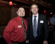 Sacramento Business Journal account executive Arthur Rangel and SAFE Credit Union vice president of business banking Ken Getz pose at the Sacramento Asian Pacific Chamber's Lunar New Year celebration.