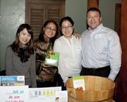 Shine Wellness intern Elain Lin, Shine Wellness CEO Evette Tsang, Shine Wellness intern Candy tang and American Home Care general manager Robert Teaznos-Pinto pose at the Sacramento Asian Pacific Chamber's Lunar New Year celebration.