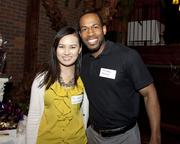 Waddell and Reed financial adviser Fei Chen and Health Corps coordinator Felix Martin pose at the Sacramento Asian Pacific Chamber's Lunar New Year celebration.