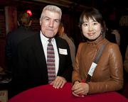 Aflac Insurance agent John Hoffman and state of California senior structural engineer Jia Wang pose at the Sacramento Asian Pacific Chamber's Lunar New Year celebration.
