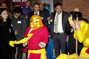 Attendees at the Sacramento Asian Pacific Chamber's Lunar New Year celebration watch a dragon dance.