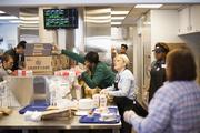 The kitchen staff at the new St. Matthew's White Castle works to prepare lunch orders on Monday.