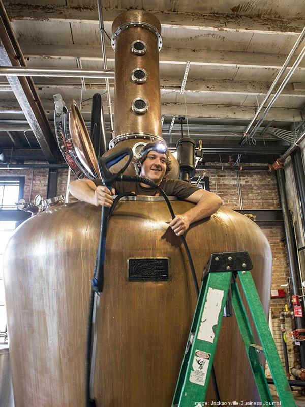 Apprentice Distiller Danny Smith cleans out one of the tanks at the St. Augustine Distillery. The distillery opened to the public March 7.