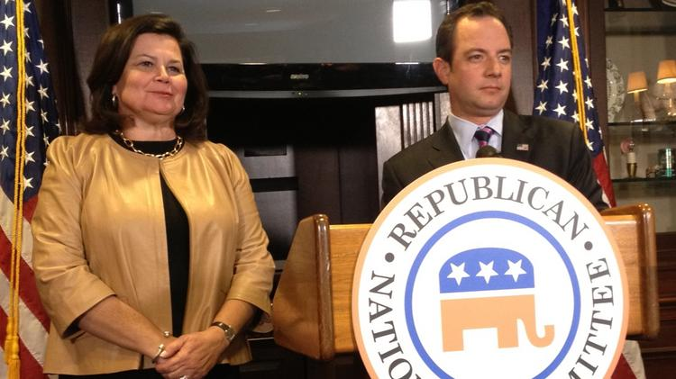 Republican National Committee Chairman Reince Preibus, right, and Enid Mickelson, who heads the site selection committee for the party's 2016 convention.