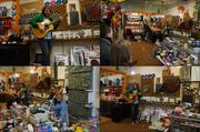 Visitors at Art Smart's Dart Mart enjoyed acoustic guitar songs.