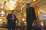 The newspaper in Abdul-Jabbar's left hand is the New York Times, which he bought in the Pfister lobby gift shop.
