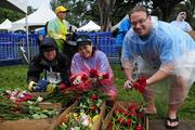 Hawaii Kai Jaycees volunteering their time at the  Hawaii Pacific Health Women's 10K at Kapiolani Park in Honolulu. From left, Lai Kin Kwong, president, Lisa Nakasone, chairwoman of board and Stan Fichtman, member.