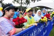 From left, Lisa Nakasone, Jon Nishihara, Annette Kim and Randall Kim, all volunteers from the Hawaii Jaycees, prepare flowers for finishers of the Hawaii Pacific Health Women's 10K at Kapiolani Park in Honolulu.