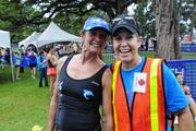 Lori McCarney, left, Kapiolani Health Foundation board member and president of Spice marketing, and KC Carlberg, race director for the Hawaii Pacific Health Women's 10K at the finish line at Kapiolani Park in Honolulu.
