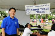 Martin Chong, massage therapy program director at Kapiolani Community College,  volunteering at the Hawaii Pacific Health Women's 10K at Kapiolani Park in Honolulu.