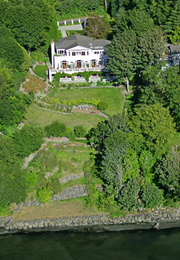 The house sits on nearly an acre on the southwest bluff of Magnolia.