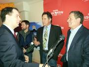 Gov. Scott Walker chats with Robert Hays and David Zucker during a press conference introducing a new series of Wisconsin tourism ads.