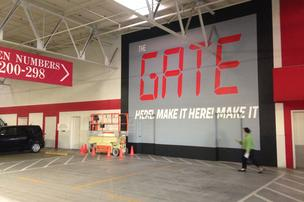 THE GATE MURAL at entrance LOGO