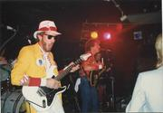 Patriarch guitarist Gregg Anderson sports a Kansas City getup — including a Chiefs ensemble and a Royals pin — during a show in the 1980s.