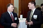 Ron Walker and Jason Newman of CohnReznick converse prior to the awards at the Boston Business Journal's 2013 Best Green Practices event at the Seaport Hotel. CohnReznick was an event presenting partner.