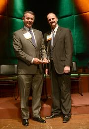 Hormel Foods Corp. Vice President of Corporate Development Fred Halvin (left) and Hormel attorney Michael Clausman accepted the company's Bold Award in the large corporate category.
