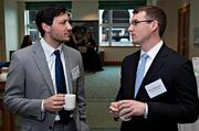 Matther Messer of Save That Stuff and Jake Marasco of Suffolk Construction talk over coffee at the Boston Business Journal's 2013 Best Green Practices event at the Seaport Hotel. Suffolk Construction was one of the honorees.