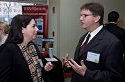 Possibly a potential interview as freelance writer Michael Hoban speaks with Earth Watch Institute's Ashley Strigle  at the Boston Business Journal's 2013 Best Green Practices event.