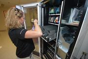 Shani Magosky, franchise owner for h.u.m.a.n. fills the machine with healthy snacks.