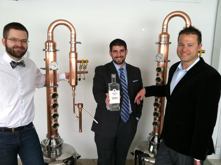 Left to right, Jon Bohlinger, Jesse Griffin and Kevin Burkart, owners of Gentleman Scholar Distillery, stand in front of their two stills in Minneapolis.