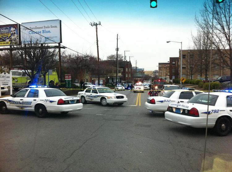 Emergency crews work an accident near Five Points where a pedestrian was struck and killed by a street trolley.