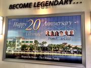 A sign marking Ultimate Software's 20th anniversary hangs in the lobby area.
