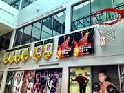 Ultimate Software uses pennants to mark achievements. The atrium of its headquarters doubles as a basketball court.