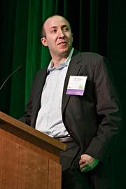 Retrofieiency's Mike Kaplan accepts their award in the invention category at the Boston Business Journal's 2013 Best Green Practices event.