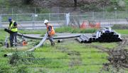 Workers line up pipe to begin the work of clearing silt and buildup away from a water intake on the Sacramento River on Jibboom Street.