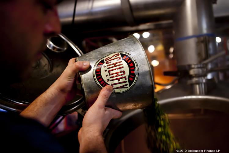 Hops are added to a boil kettle at St. Louis Brewery's Bottleworks in St. Louis.