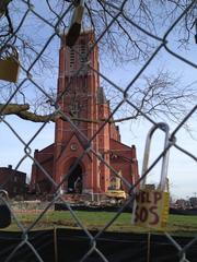 """A fence surrounds the church to keep people safe. """"We don't want anybody getting hurt,"""" said Steve Powers of Nigro Cos. Protesters attached padlocks to the fence with messages such as """"Help SOS"""""""