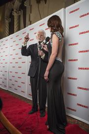 Martin Cooper hits the red carpet at Cinequest and gesticulates with the host.