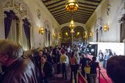 Crowds rush into the California Theater to watch the opening night movie at Cinequest.