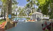 A view from the home overlooking the backyard pool and cabana area.