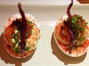 Deviled eggs with crispy pancetta, jalapeno, smoked paprika and chives