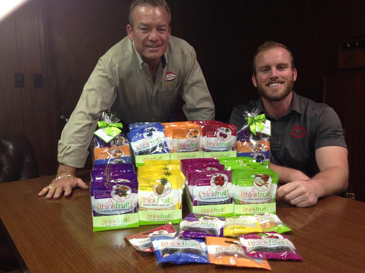 Tracy Schulis (left), senior vice president, and Bryan Schulis, sales and marketing, with ThinkFruit from Paradise Inc.