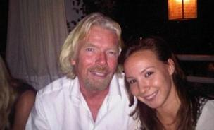 Richard Branson, CEO of Virgin poses with Autumn Radtke.