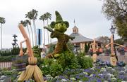 Sorcerer Mickey rallies the troops in a Fantasia-themed topiary scene.