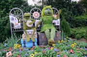 Kermit and Miss Piggy topiaries. That's right, there's a Muppet movie coming out this year.