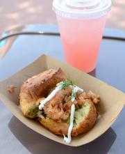 The potato and cheddar cheese biscuit with smoked salmon tartare and chilled rose blush lemonade from The Buttercup Cottage kitchen in the United Kingdom pavilion
