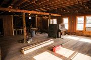 The second floor of Beer Engine features reclaimed wood flooring and a stage.