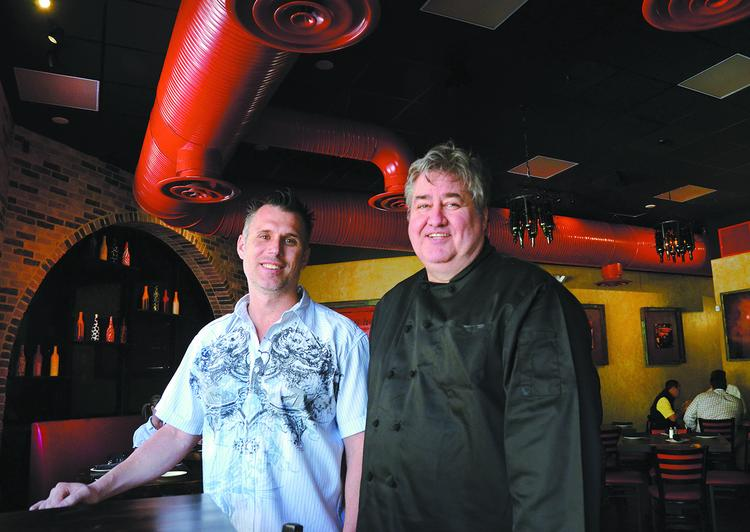 Cafe Red co-owners Greg Peters and Tom Hughes