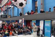CEO Colin Angle talks about iRobot's military robots, while Swissnex's helium-filled robotic soccer ball hovered above.
