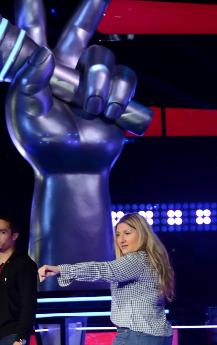 Senior supervising stage producer Marie Leguizamo directs stand ins and production staff during a rehersal for Telemundo's Le Voz Kids at Universal Studios.